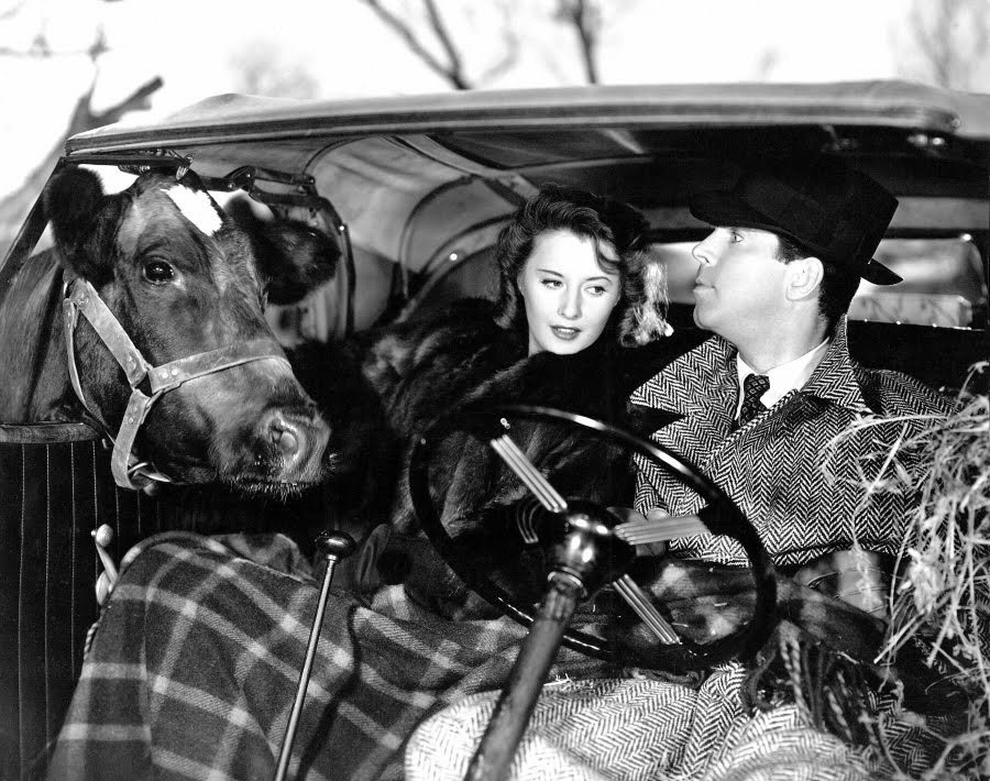 I'm afraid I can do this cow thing for a long time. Here's a still from one of our favorite movies, Remember the Night ('40) with Barbara Stanwyck and Fred MacMurray.