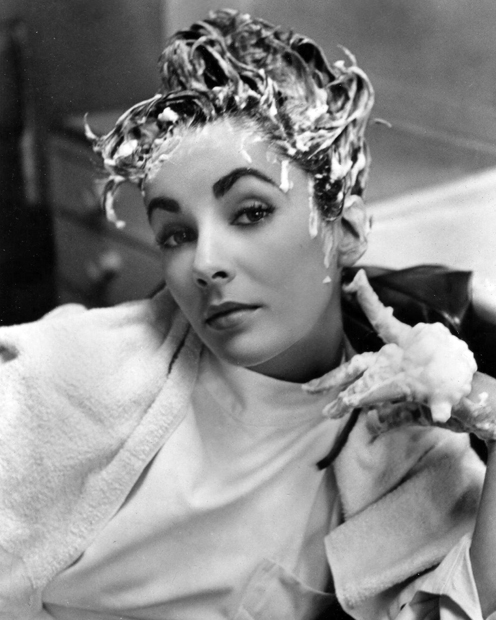 "And here's a wonderful photo of Elizabeth Taylor (1932 - 2011) getting her hair shampooed during production of ""Ivanhoe"" 1952."