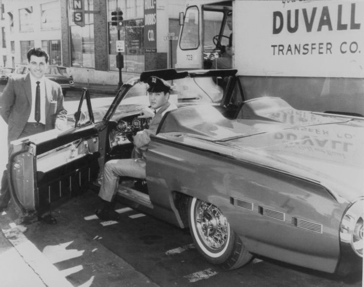 Elvis in his 1962 Ford Thunderbird Sports Roadster.