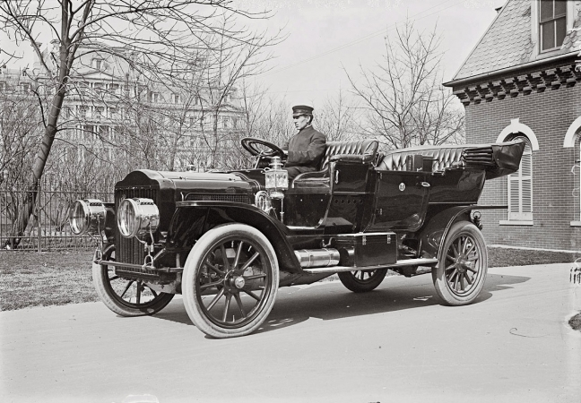 President Taft's White Model M steam-powered touring car on White House grounds, March 1909.