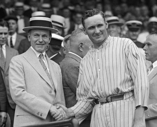 President Calvin Coolidge shakes hands with the great pitcher Walter Johnson, AKA The Big Train, 1924.
