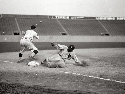 Ty Cobb hits a triple and slides safely into third base, 1924.