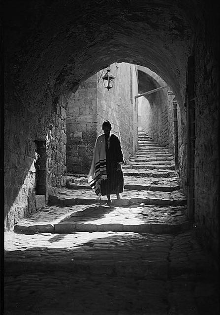 A Jewish man walks the streets of Jerusalem, 1920s.
