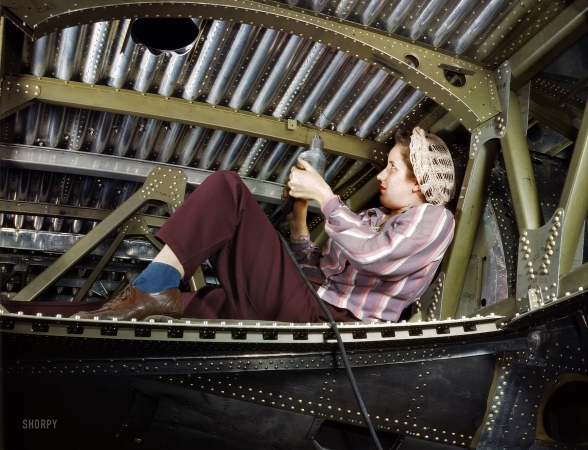 Rosie rivets an A-20 bomber, Douglas Aircraft, Long Beach, CA, 1942.