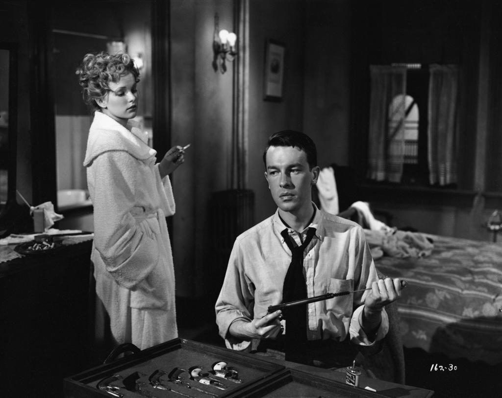 In one of our favorite movies, Gun Crazy ('50) John Dahl strives to please the femme fatale Peggy Cummins.