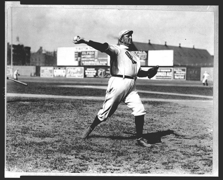 Cy Young, Boston Red Sox pitcher, throwing a baseball at Huntington Avenue Grounds, Boston. Photographic print by Bain News Service, July 23, 1908.