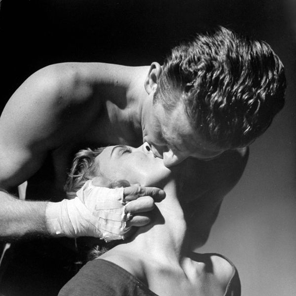 "Issur Danielovich AKA Kirk Douglas shows Marilyn Maxwell just what it means to be kissed by a real man in ""Champion"" ('49)."