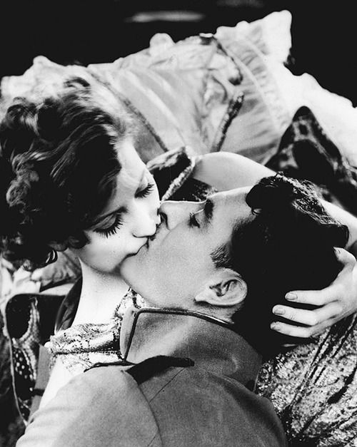 In Flesh and the Devil ('26), I think Greta Garbo is showing John Gilbert that she's the man in the kiss. I believe this might be the first time in a Hollywood movie that the woman assumes the dominant position for the lip clench.