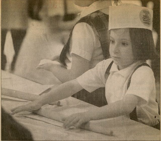 In 1992 the Los Angeles Times did a story about Jewish children baking their own matzoh for Passover. The photo featured Offspring #2 preparing the dough for her matzo.