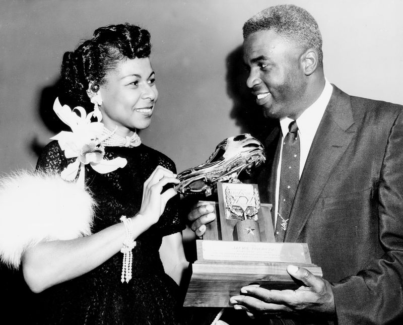 Jackie Robinson and his wife Rachel receive an award at a fundraiser for the United Jewish Appeal.