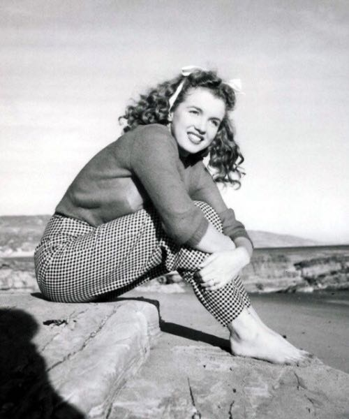Photos of Marilyn Monroe when she was young and not yet a pro playing to the camera are particularly charming and powerful.