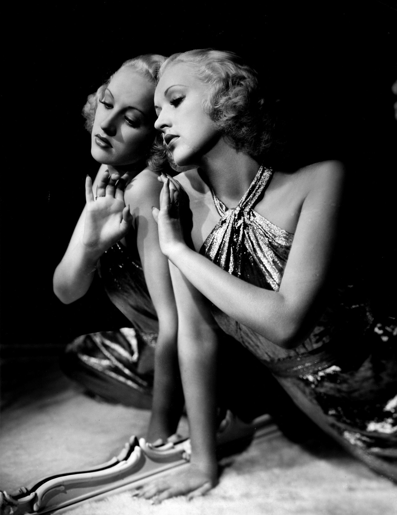 Admit it, when you think of betty Grable you are thinking: legs. But Eugene-Robert Richee's 1930s portrait of Grable goes beyond the obvious.