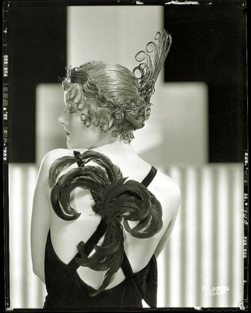 We don't think of Myrna Loy, born Myrna Adele Williams, as a star possessed of animal magnetism. That's because we view her as the well-bred but plucky Nora Charles. But early in her career Loy was typecast as an oriental vamp. In this feathered costume Loy projects as a dangerous seductress.