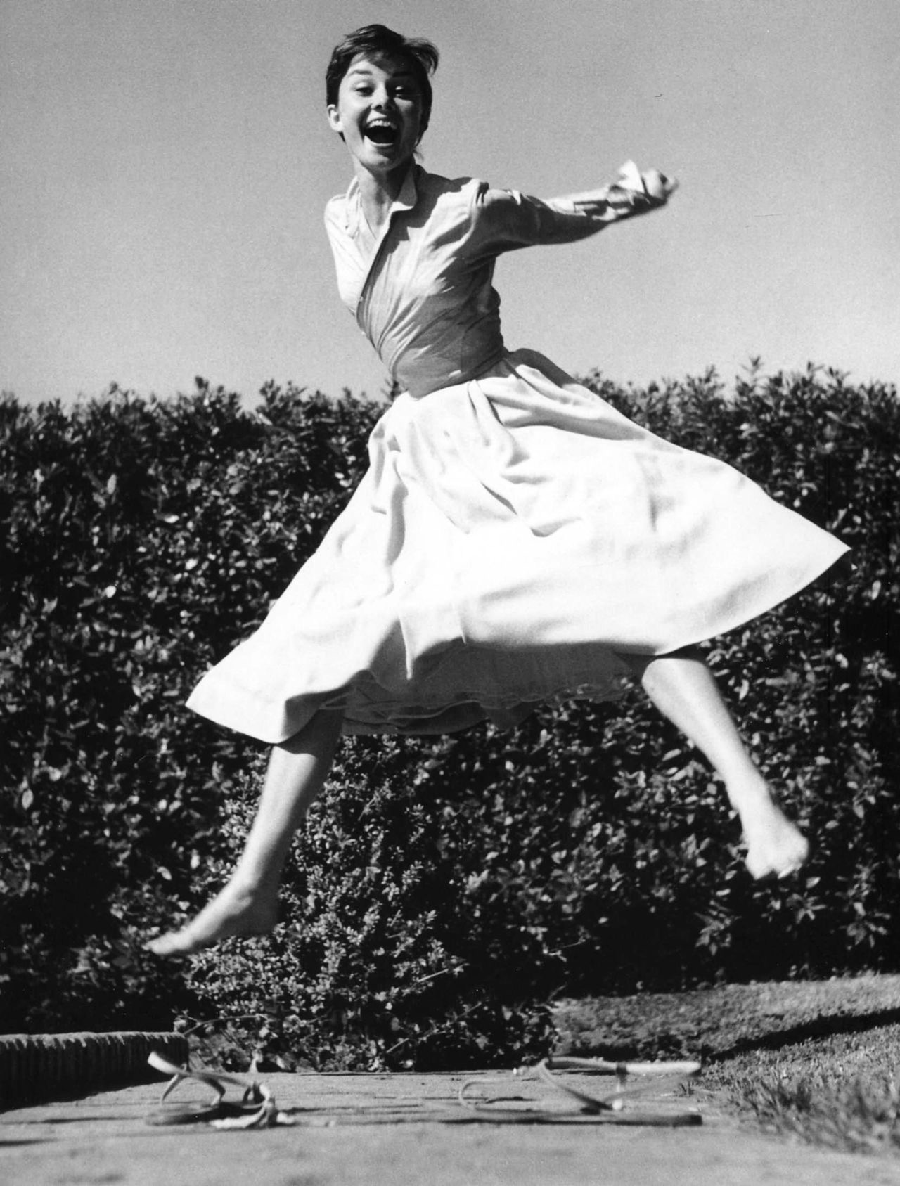 Audrey Hepburn jumps for joy. Photo by Philippe Halsman, 1955.