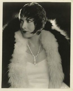 "Director Josef von Sternberg, born Jonas Sternberg, obsessively costumed his leading ladies in feathers, like birds of prey. Evelyn Brent, born Mary Elizabeth Riggs, a sultry leading lady of the 20's and 30's, was the first movie star to get the von Sternberg treatment. This is a still from ""Underworld"" (1927) where Brent plays a gun moll named Feathers McCoy. Costumes by Travis Banton."