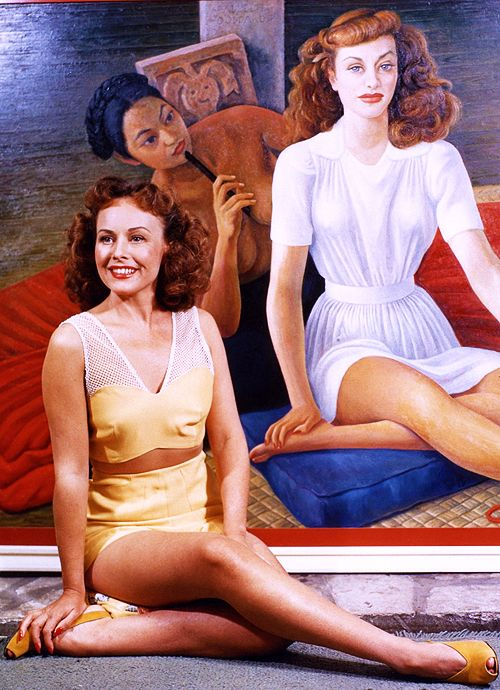 Paulette Goddard and her portrait, painted by Mexican artist, Diego Rivera, 1941.