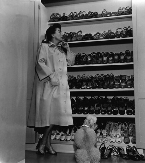 Joan Crawford proudly displays her shoe closet.