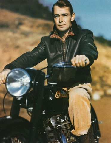 Alan Ladd on what appears to be an Indian motorcycle, 1950s.