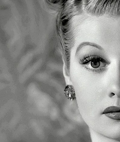 24th April 1945: American actress Lucille Ball (1910 - 1989) wearing an elaborate rolled hairstyle.