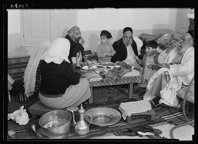 Yemenite Jewish family celebrates the Passover seder in Jerusalem, April 1939.