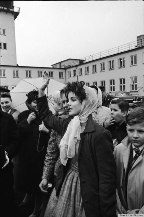 Priscilla Beaulieu waves to Elvis as his plane takes off from Germany for the U.S. Life, March 2, 1960.