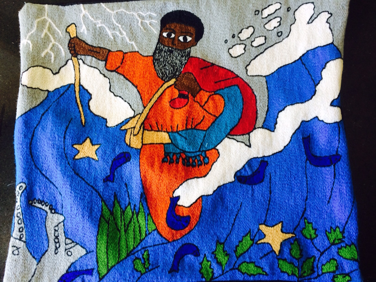 This women art was made by an Ethiopian Jew. It shows Moses splitting the Sea of Reeds. I use it as a chill covering on Shabbat.