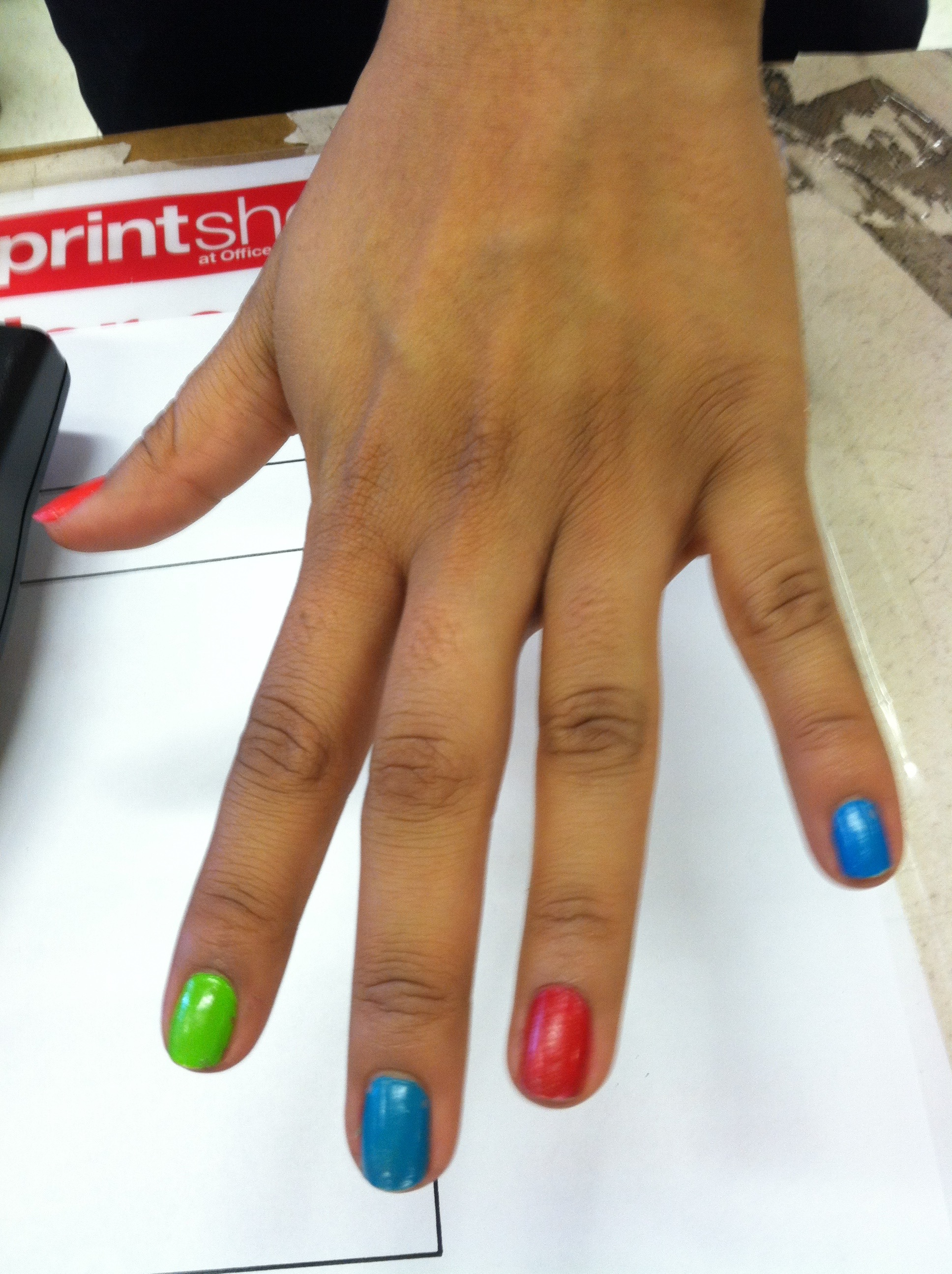 "I was picking up some office supplies the other day. At the cash register, I noticed the multi-colored nail polish of the cashier. I asked her if it was okay if I took a picture. She said: ""Are you kiddin' dude, fire away!"""