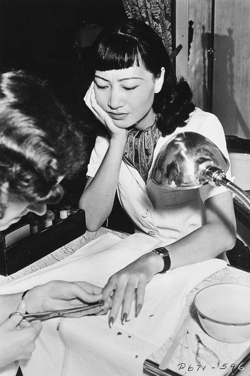 Anna May Wong getting a manicure, 1939