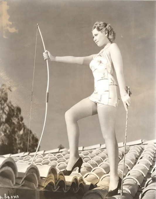 This has to be one of the strangest publicity photos I have ever seen. Joan Blondell, one of the great actresses of Hollywood's Golden Age, is in heels, on a Spanish tiled roof (hey it could be Casa Avrech) in a bathing suit, with bow and arrow. Blonde was a trooper. This pic is just nuts.