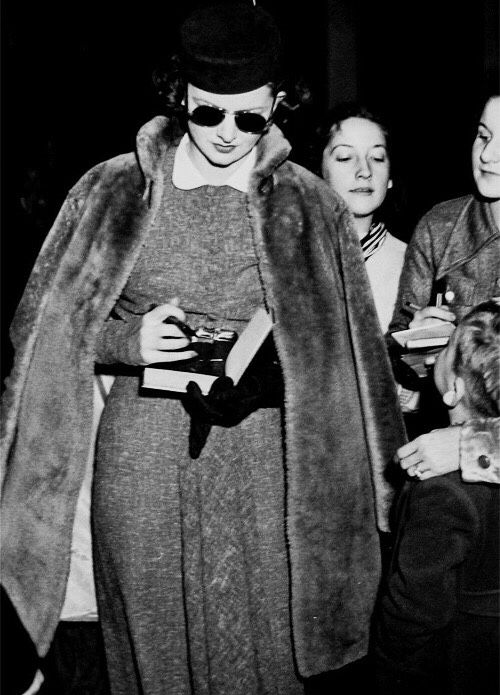 Myrna Loy signs autographs for fans. The sunglasses are too cool.