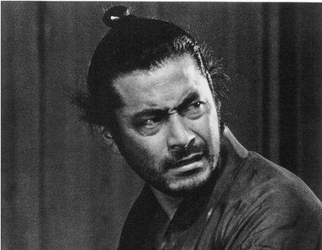 Toshiru Mifune's hair is in the classic Samurai top knot tradition.