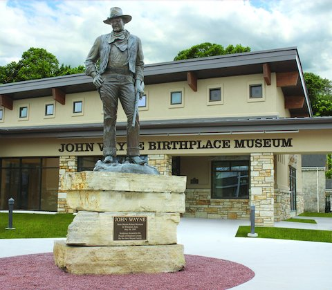Statue of John Wayne in the plaza of the John Wayne Birthplace Museum, Winterset, Iowa.