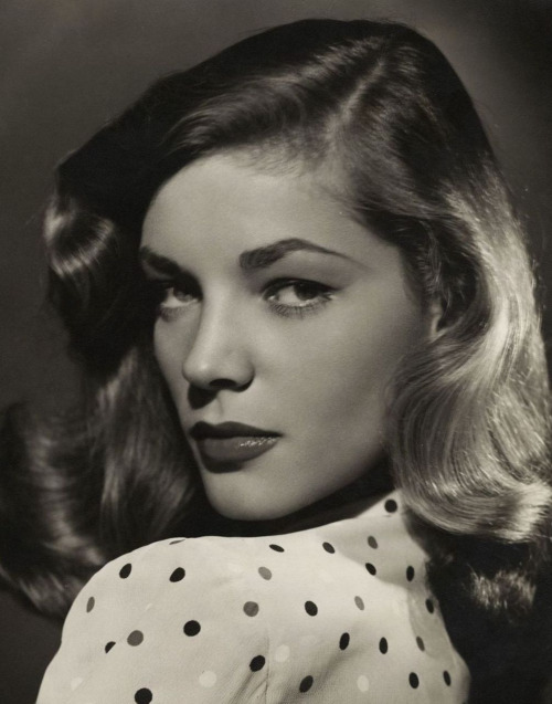 """Lauren Bacall (1944, photo by Bert Six) The phone in the bedroom rang. I picked it up. It was Lauren Bacall. """"I've been waiting for Tony for an hour,"""" Lauren said angrily. """"Where the hell is he?"""" """"Lauren,"""" I replied, """"you're complaining to me because my husband is late for a date with you?"""" """"Well, dear,"""" she said, """"If your husband doesn't respect your marriage, why should I?"""" """"You're absolutely right, Lauren,"""" I said, """"He'll be there in a few minutes. Look for a man with a bandaged head.'"""" —Shelley Winters, in her autobiography The Middle of My Century."""