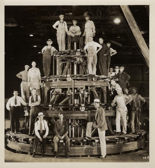 "Behind-the-scenes shot of the Warner Bros. electrical department & the mechanism they built to produce the spinning fountain in Busby Berkeley's Footlight Parade ""By a Waterfall"" routine."