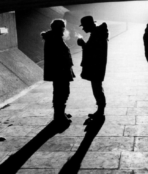 "Stanley Kubrick & Malcolm McDowell on the set of A Clockwork Orange (1971, dir. Stanley Kubrick) (via) ""Well, as you know, when Singing in the Rain came out, for generations of people, [Gene Kelly] swinging around that lamp post and slapping in that water, and singing…it's one of the most euphoric moments we've ever seen on film. So when I had to come up with something for this sequence, which involved my character in a very brutal situation, that's when he's happiest. So Singing in the Rain just popped out. I just started singing it, and [Stanley] Kubrick bought the rights and we redid the whole thing and incorporated it. A footnote to that is that a year afterward, when the film had been out and it was a big hit, I was invited to come to Hollywood by Warner Brothers. I came out and it was very nice to meet everybody. I had never been to Hollywood before. And some guy who was my minder said, 'Hey, there's a party in Beverly Hills tonight, Malcolm. Do you want to go, there's going to be lots of stars there?' And I went, 'Yeah! I would love to!' I was like a kid in a candy store. And we go and he said, 'Hey, you won't believe this. Gene Kelly's here. Would you like to meet him?' And I went, 'Oh yeah!' (laughs) So he had his back to me and he tapped him on the shoulder and said, 'Gene, I'd like to introduce you to Malcolm McDowell' and he looked at me and…then turned around and walked off. But you know, I totally got it. I totally understood. I took his glorious moment and put a different spin on it. I guess I kind of ruined his moment in a way. But of course, it was an homage to him, because it was so amazing. And so indelible in me as a person, that I blurted it out and started singing it while filming the scene."" —Malcolm McDowell"