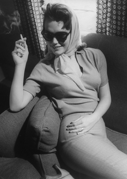 """Lee Remick in Anatomy of a Murder (1959, photo by Gjon Mili for LIFE) On her studio's attempts to promote her as """"America's Answer to Brigitte Bardot"""": """"Anyone who'd want to build me up as a sex siren would have to be crazy. Why is it most actresses must be bizarre, vulgar or temperamental to make good copy? Everyone in Hollywood tells me I have to develop an interview personality if I want to keep the press happy. They want me to be something I'm not…I'm an actress and a woman and I hope, a lady. But I found being a lady is a hardship here. It's not encouraged. What I should be is a glib person, quick on repartee, and full of colorful quotes I gleamed from the 'Reader's Digest' just before the interview!'"""" 'All I need are one or two good quotes, either controversial or funny, and I've got a column,' I said."""" """"'No,' said Miss Remick firmly. 'I can't think of one!' Then she brightened, 'I have it,' she said, 'you can compare me with Greta Garbo. I have big feet too.' —excerpted from Joe Hyman's 1959 New York Herald Tribune profile, """"Lee Remick Boasts Garbo Feet"""""""