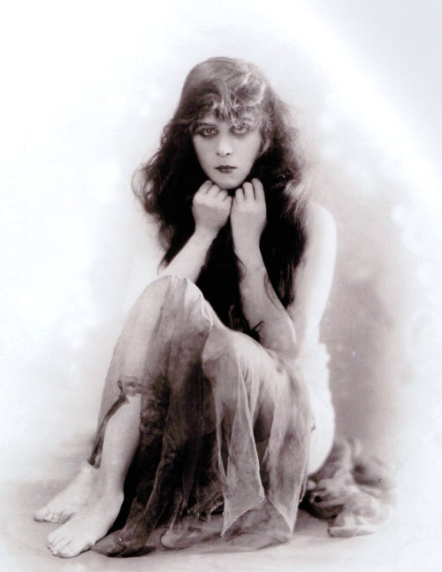 "Theda Bara b. Theodosia Goodman, in a publicity shot for A Fool There Was (1915, dir. Frank Powell) (via) ""I was held up as one who delighted in the lure of destruction and evil-doing…hardly a day passes that the postman does not bring me letters written along similar lines. Many of them attack me most unmercifully. Some intimate that no woman could portray [femme fatales] without having had the actual experience.  Here is a letter I received during the past few months: You are a menace to the human race. Man is a mere toy in your hands or those of women like you. Your type inevitably leads to ruin and destruction. Those glittering eyes are like those of the serpent, except they are more dangerous. Such letters hurt. It is impossible to accustom myself to them. Why do people hate me so? I try to show the world how attractive sin can be, how very beautiful, so that one must be always on the lookout and know evil even in disguise. I am a moral teacher then. But what is my reward? I am detested.  People seem to forget that I am only an actress; that an actress should never show her real self to an audience, else she ceases to be an actress."" -Bara, quoted in The Pittsburgh Press (April 1916)"