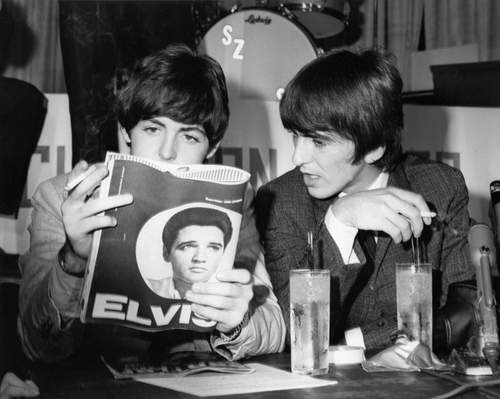 George and Paul read about Elvis.