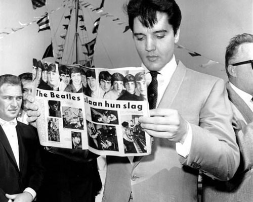 Elvis reads about The Beatles.