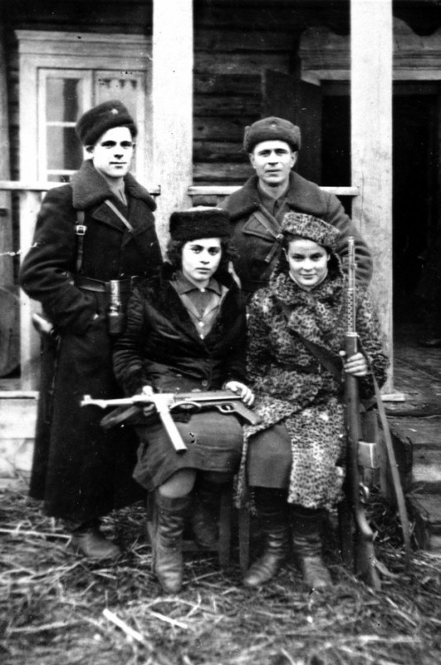 Jewish partisans in Poland. Photographer Faye Schulman, bottom right. In Aug.1942, the Germans murdered 1,850 Jews from the Lenin, Poland ghetto, including Faye's parents, sisters, and younger brother. They spared only 26, among them Faye for her photographic abilities. They ordered her to develop photographs of the massacre. Secretly she made copies. During a partisan raid, she fled to the forests and joined the Molotava Brigade, a partisan group made mostly of escaped Soviet Red Army POWs.