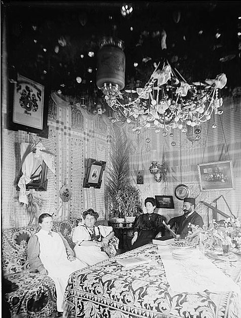 Ashkenazi family (circa 1900) in the succah beneath the chandelier