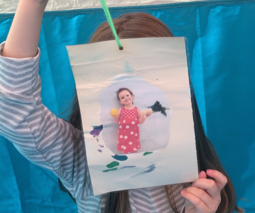 Maayan prepares to decorate the Sukkah with a picture of her sister, Lielle.