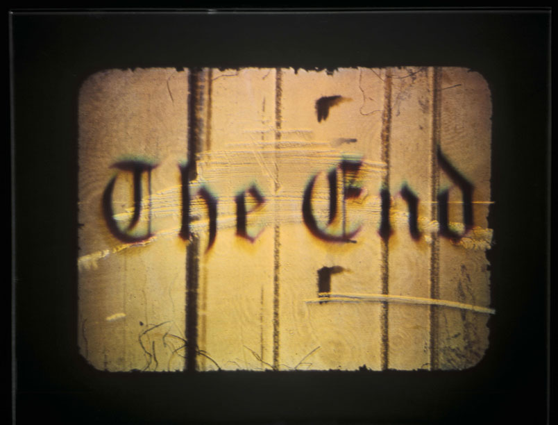 Ed Ruscha, The End #1, 1998/2007. Silver-halide film laminated to glass, 27.3 x 34.9 cm.