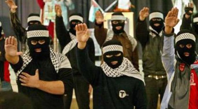 Members of Hamas are not hailing a cab. The Nazi salute is part and parcel of Islamist Jihad.