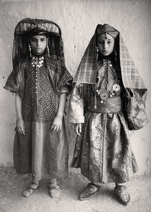 Two Jewish girls wearing traditional costumes worn during the 8 days of wedding festivities. Erfoud, Morocco, ca. 1934