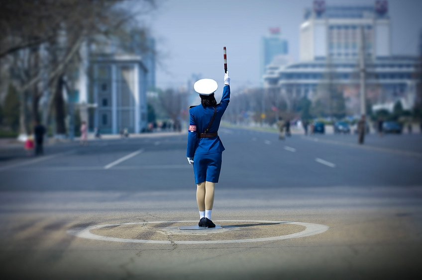 Photo by Ric Lafforgue, North Korean Traffic Officer. There are hardly any cars in North Korea so traffic cops perform a ritual dance that has no relation to reality.