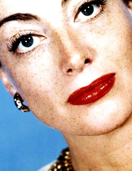 "A rare view of Joan Crawford's freckles, 1947. A natural redhead (her friend the actor/interior designer Billy Haines nicknamed her ""Cranberry""), Joan never attempted to hide her freckles in real life, but they were hidden in her films and most publicity portraits with careful editing and over-lighting. When she posed for portraits for the great George Hurrell, Crawford slathered her face with Vaseline which picked up the reflection of the bright lights Hurrell used, allowing her freckles to be more easily obliterated during the editing process. As someone who freckles a tad in the sun myself, I find her natural complexion quite charming."