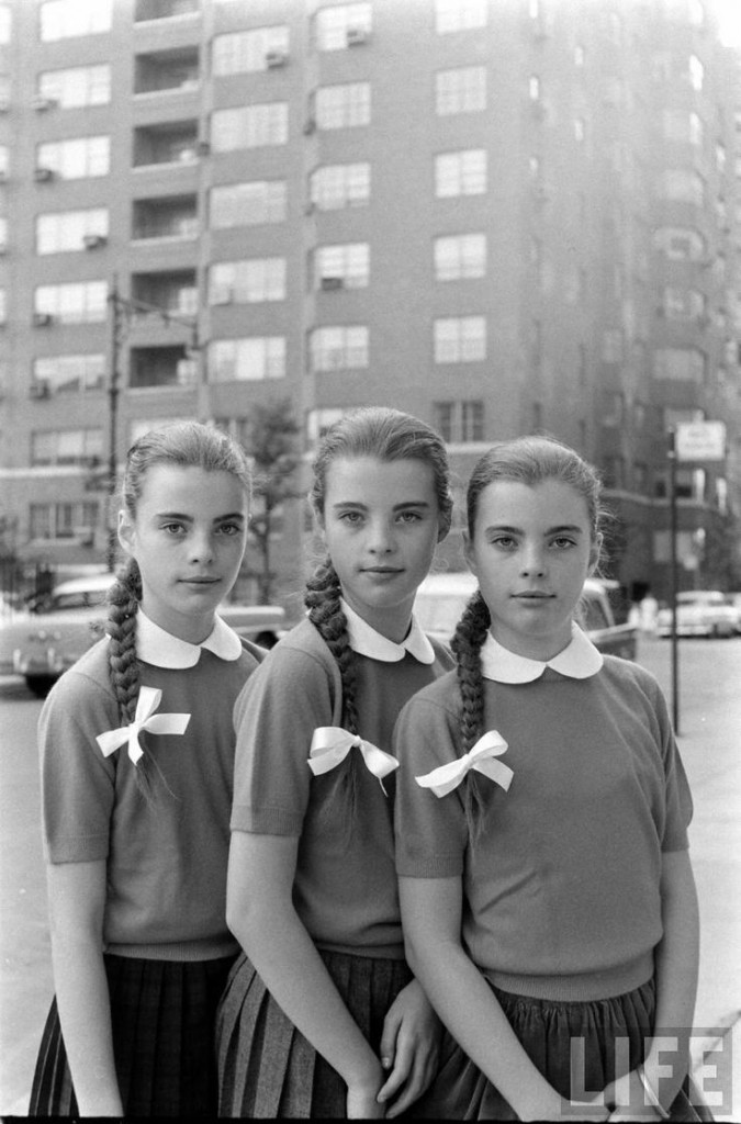 Triplets Christina, Katha, and Megan Dees Modeling Their Braids Before Getting Haircuts (Nina Leen, LIFE Magazine, September 1, 1956)