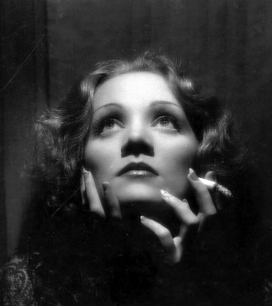 When shooting a film, Dietrich positioned a full-length mirror beside the camera so she could keep an eye on herself. Dietrich's knowledge of lighting and camera were often more sophisticated than the cameramen and directors with whom she she worked. Her face was a living canvas on which Dietrich labored for perfection. If you look closely at her movies of the 40's, when she was no longer working with Joseph von Sternberg—real name Jonas Sternberg—you can, on occasion, see the white line Dietrich inscribed down her nose to give it a more streamlined appearance.