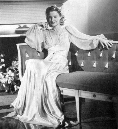 Costume designer Edith Head helped Barbara Stanwyck achieve stardom with her designs for The Lady Eve, 1941. Until then, Stanwyck had usually not been cast in roles that called for high fashion. Stanwyck was generally indifferent towards her clothing. She preferred comfort over fashion. Head studied Stanwyck and saw that she was slender with perfect posture, but she had a long waits and low-slung derriere. Previous costume designers coped with his by cheating her waistline up and then hiding the rest under full skirts even when full skirts were out of fashion. Edith Head was determined to raise Stanwyck's waits and keep her in straight skirts. Head did this by designing a belt that was wider in the back than the front, and then increased fullness over the bust and sleeves to divert the eye. The results were sensational and Barbara Stanzaic, over night, became a fashion icon. For the rest of her career, Stanwyck insisted that Edith Head design her wardrobe.